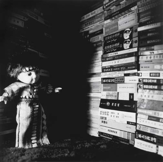 "Liu Xia once wrote of her doll photos in a poem: - ""Living together with the dolls, - Surrounded by the power of silence, - The world open around us, - We communicate in gestures."" - (from ""The Power of Silence,"" November 1998)."