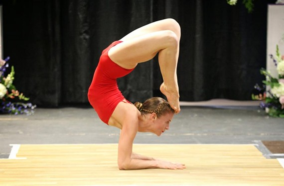 Local yoga instructor Garland Hume bends into in a scorpion and tiger pose during the USA Yoga National Competition in New York.