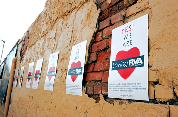 LovingRVA posters plaster the former Weiman's Bakery in Shockoe Bottom last month during Mayor Dwight Jones' announcement of a proposal to build a baseball stadium in the neighborhood.