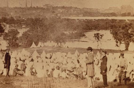 Maj. Thomas P. Turner, center in felt hat, was commandant of the Confederate prison encampment on Belle Isle