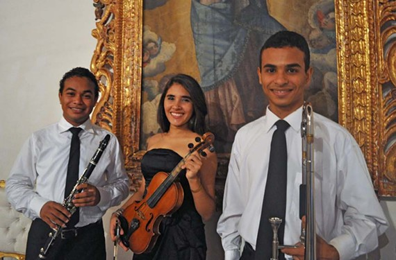 """""""Making dreams come true."""" Three recent high school graduates from Colombia are making musical connections in Richmond this summer. From left, clarinetist Juan Camilo Gonzalez, violinist Sandra Rendon and trombonist Cristian Puello."""
