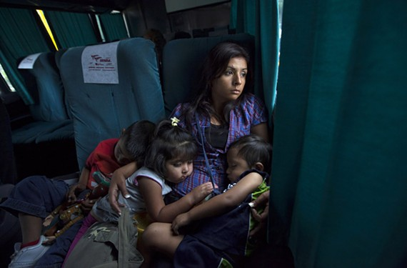 Marisol and her children ride a bus from Mexico City to Dallas in this 2011 photo. During a previous ride, gunmen boarded the bus, robbing everyone except Marisol, because she was a young mother traveling with children. - JANET JARMAN