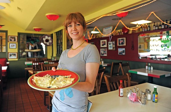 Mary Reilly serves a cheese quesadilla at Su Casa. - SCOTT ELMQUIST