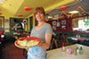 Mary Reilly serves a cheese quesadilla at Su Casa.