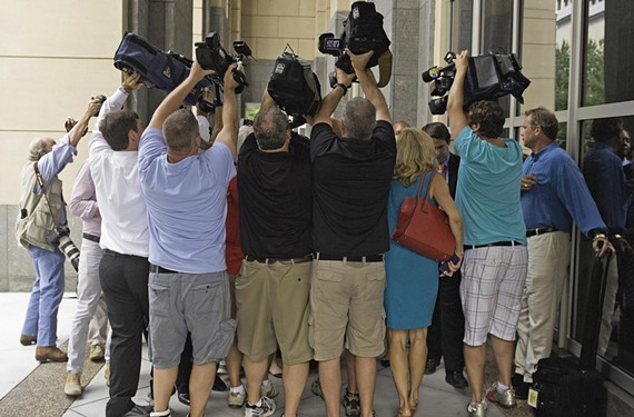 Mass media: the ritual of the huddle at the federal courthouse downtown.