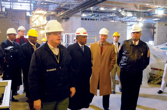 "Mayor Dwight C. Jones accompanies Sheriff C.T. Woody on a construction tour of the city's new jail in December 2012. Richmond's previous leaders long had discussed the need to replace the city's old jail, which was overcrowded and in poor condition, but the project was hampered by a state funding formula that encouraged regional jails and by the surrounding counties' unwillingness to cooperate with Richmond, according to the Rev. Ben Campbell in his book, ""Richmond's Unhealed History."" The jail is expected to open to a full house in February. - SCOTT ELMQUIST"