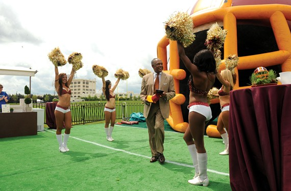 Mayor Dwight C. Jones revels in the grand opening of Redskins Training Camp on July 8. What followed was a three-week spectacle of feverish fandom and boosterism, though it's uncertain whether the city will recoup a near $15 million investment. - SCOTT ELMQUIST