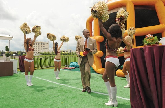 Mayor Dwight Jones takes the field at the Redskins' training camp ribbon cutting on July 8. - SCOTT ELMQUIST