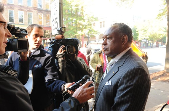 Mayor Dwight Jones talks to reporters outside of the Empire Theatre, now the Sara Belle and Neil November Theatre, in early November. - SCOTT ELMQUIST