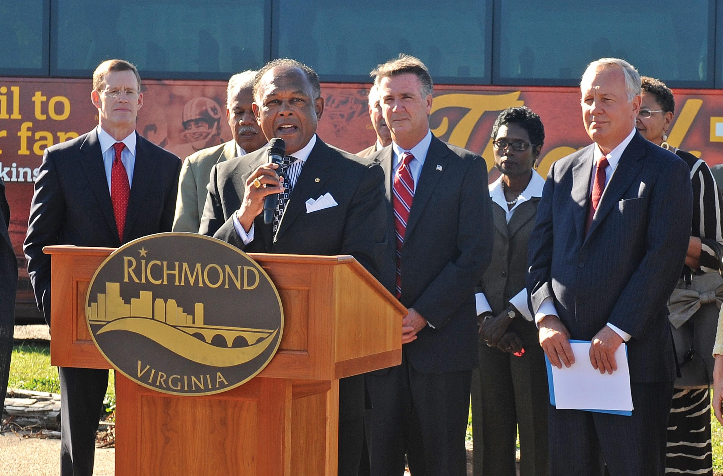 """Mayor Dwight Jones, with Redskins General Manager Bruce Allen over his left shoulder, unveils plans for a new training camp last week: """"For those who said it could not be done, sit back and take notice."""" - SCOTT ELMQUIST"""