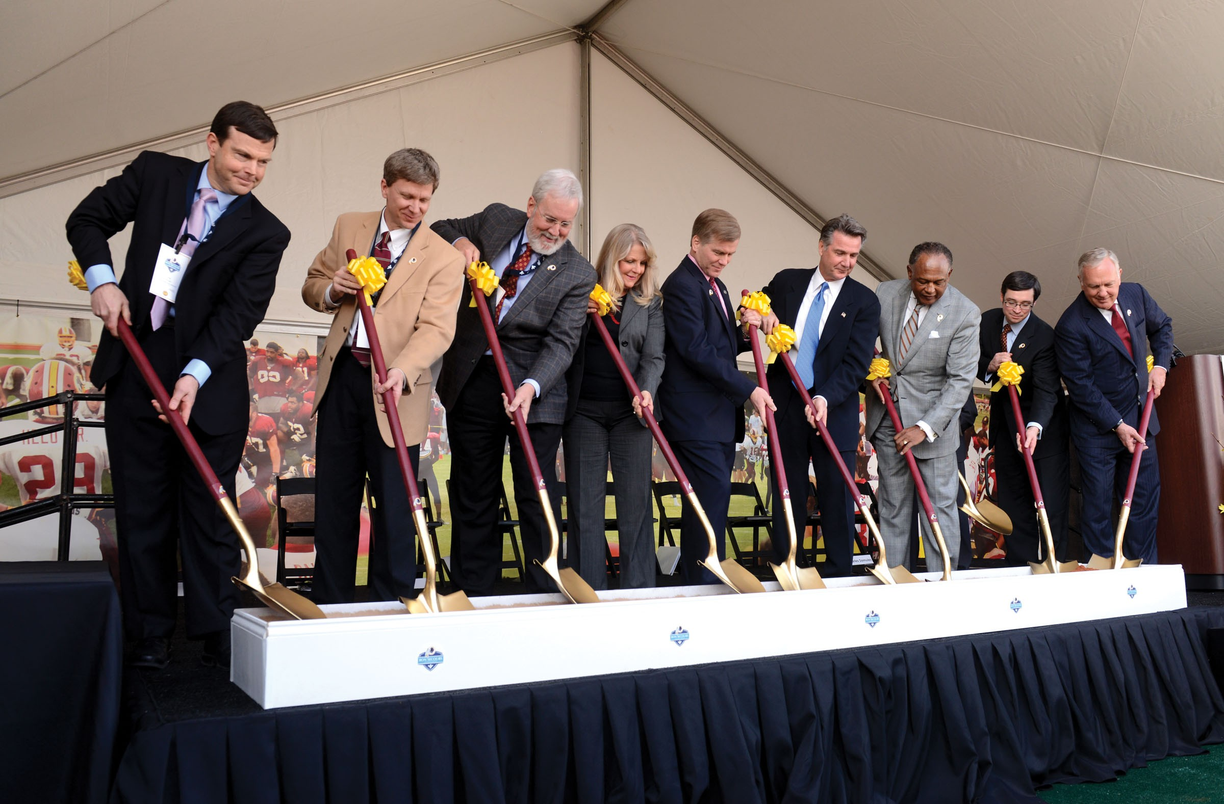 Mayor Jones, third from right, with City Council President Charles Samuels, Gov. Bob McDonnell and his wife, Maureen, and other officials help break ground Feb. 14 on the team's training camp in Richmond. - SCOTT ELMQUIST