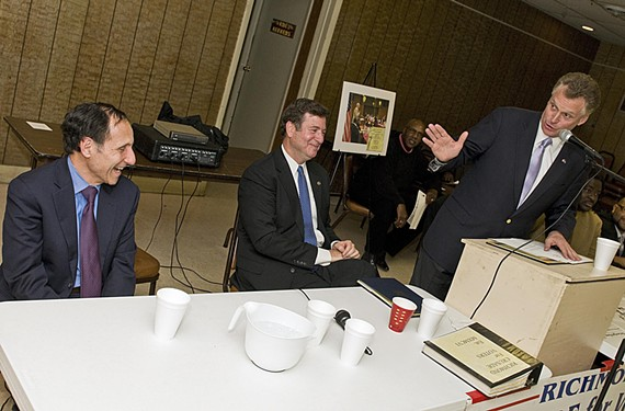 McAuliffe, with Democratic strategist Paul Goldman and former Republican Gov. George Allen, addresses a meeting of the Richmond Crusade for Voters after the election in November 2009. - ASH DANIEL