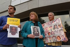 Members of the Survivors Network of those Abused by Priests call for Aguilar to step down at a late-May protest in Richmond. - SCOTT ELMQUIST