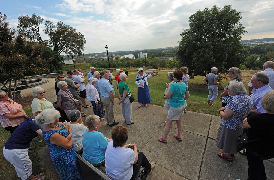 Metro Richmond tour guide Emily D. King discusses the history of the Libby Hill overlook to a group from Britain. - SCOTT ELMQUIST