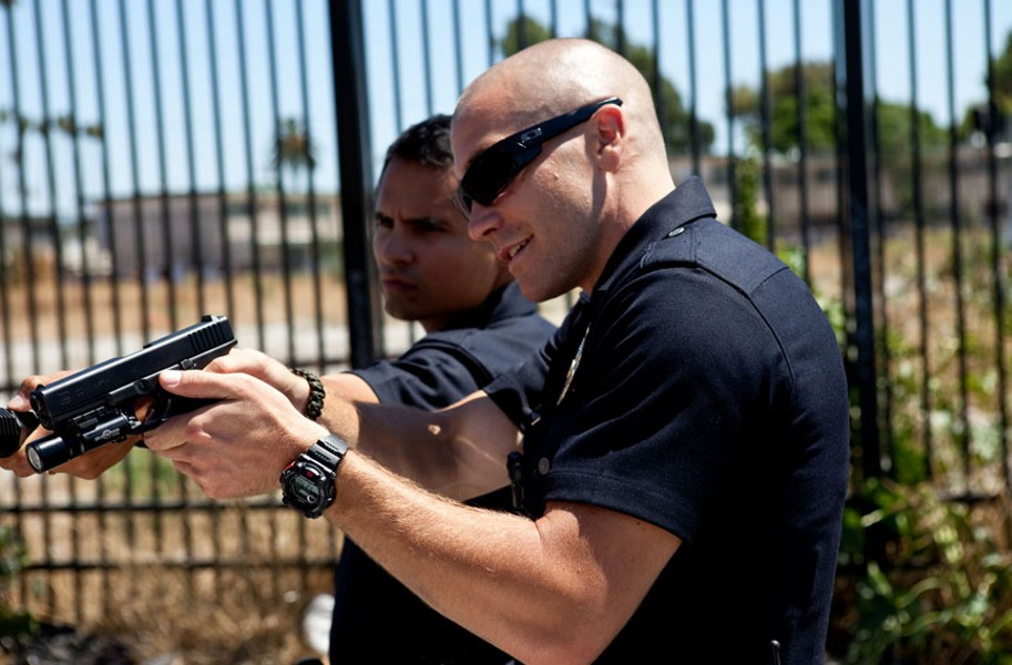 Michael Peña and Jake Gyllenhaal play cop partners who film their daily work in Los Angeles. - OPEN ROAD FILMS