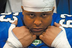 Michael Woodhouse, a 6-foot-4-inch, 240-pound defensive lineman, before kickoff. - SCOTT ELMQUIST