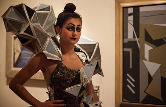 """Model Heidi Ulrich, who wore the best in show design by Annie-Ward Love of Henrico High School, from the inspiring painting""""Construction #5"""" by Ralston Crawford. - BRIGET GANSKE"""