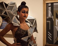 """Model Heidi Ulrich, who wore the best in show design by Annie-Ward Love of Henrico High School, from the inspiring painting""""Construction #5"""" by Ralston Crawford."""