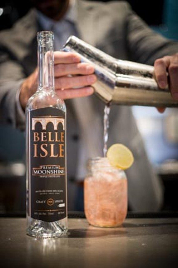 Moonshine becomes us, most recently in the form of Belle Isle Craft Spirits. Managing partner Vincent Riggi says the new company's premium moonshine will be clean and crisp even when we're not. - BELLE ISLE CRAFT SPIRITS