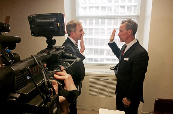 Morrissey arrives late, delayed by ice, and is promptly sworn in by House Clerk Paul Nardo in front of a mass of cameras in his office. - NED OLIVER