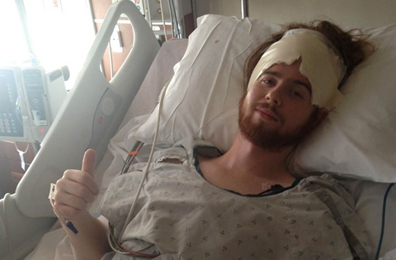Nashville transplant and musician Andrew Leahey in his hospital bed after recent surgery to remove a brain tumor.