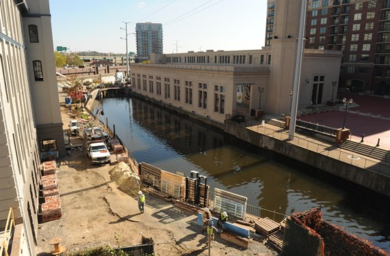 New apartments and a Mexican restaurant are scheduled to open soon at the Locks on the canal's north bank, at left. Meanwhile, the city is searching for a contractor to upgrade the plaza on the south bank. - SCOTT ELMQUIST