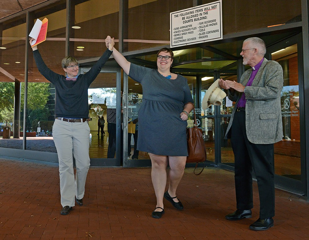 Nicole Pries and Lindsey Oliver exit the court house, marriage license in hand. - SCOTT ELMQUIST