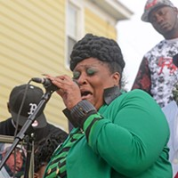 """Scenes From the Vigil for Kiarri Edwards Nikki Jackson, the victim's sister sings """"What God Has For Me, It Is For Me"""" in her brother's honor. Scott Elmquist"""