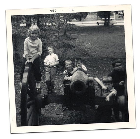 """Nine-year-old Jackson Slipek (second from left) """"takes a bullet"""" while his sister, Margaret (at left) and friends climb around Confederate earthworks at Byrd Airport (now Richmond International) in 1966."""