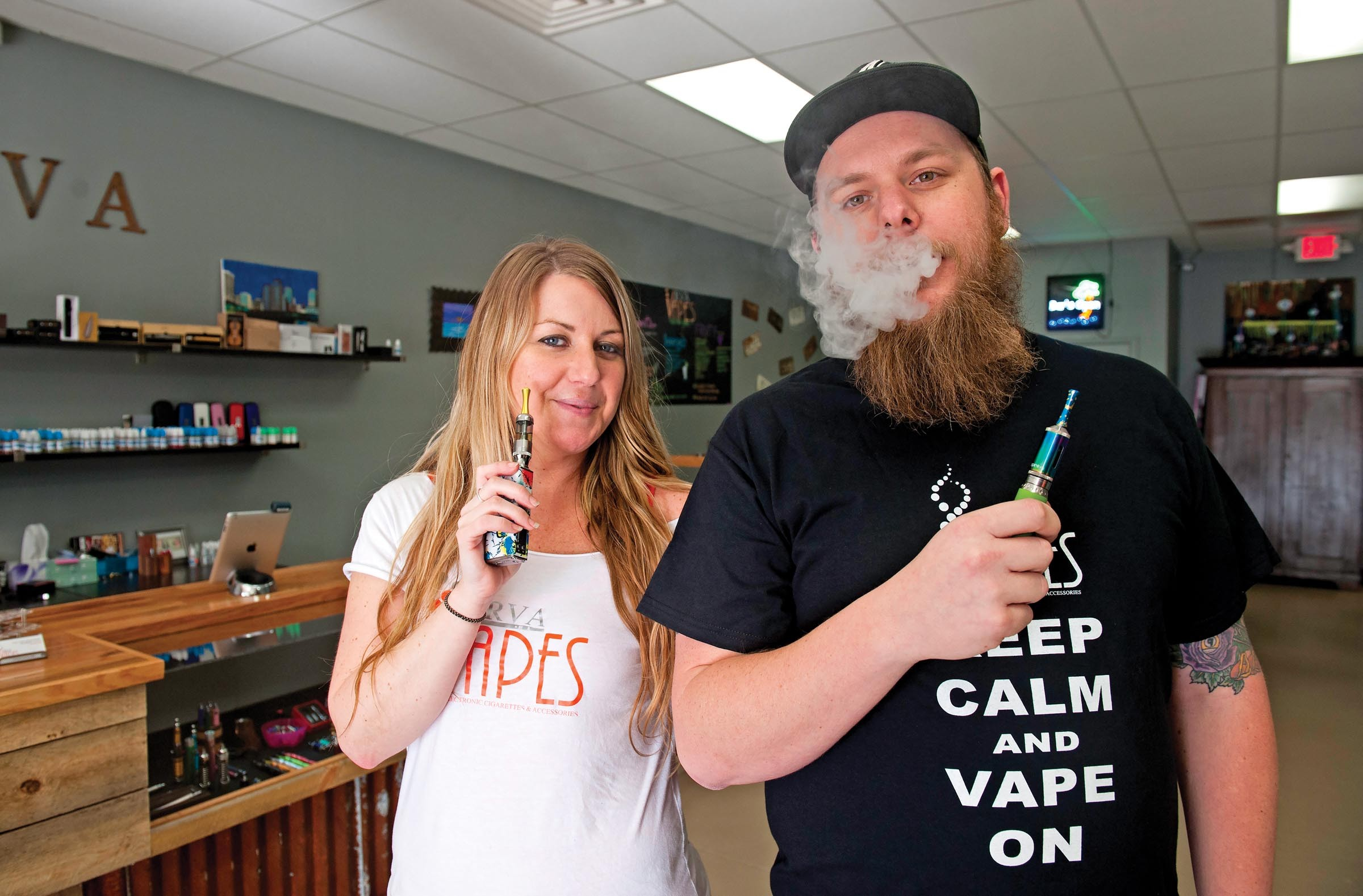Noelle Pryor and Chip Anderson are co-owners of RVA Vapes, Richmond's newest electronic cigarette store and lounge. - SCOTT ELMQUIST