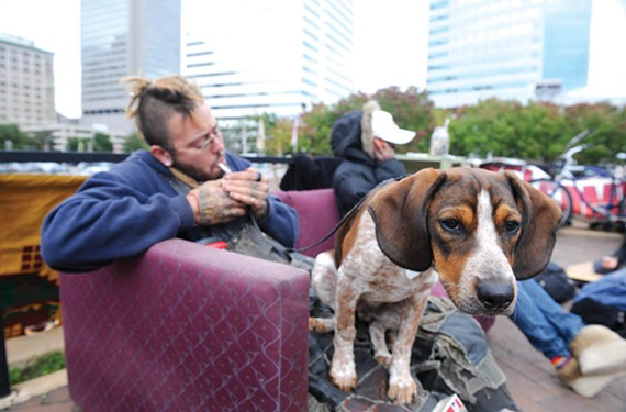 Occupier Waylon, known as Mess, passes the time with a companion during the second week of the occupation. - SCOTT ELMQUIST