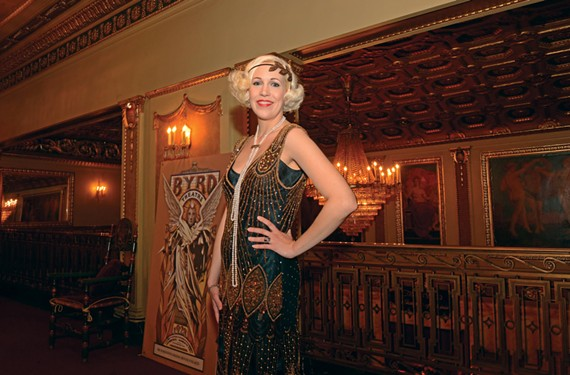 Olivia Lloyd, president of the Art Deco Society, poses in period costume upstairs at the Byrd Theatre. - SCOTT ELMQUIST