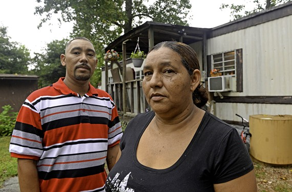 Omar Zuniga's parents, Hermes and Yolanda, say they got no help from the school district, but found an advocate in community organizer Dustin King, below. - SCOTT ELMQUIST