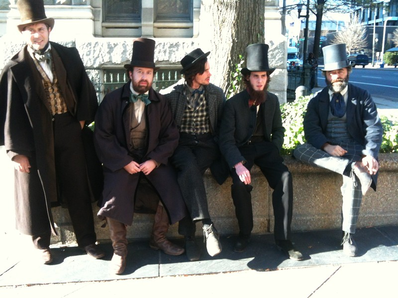 On a break from shooting near Capitol Square, the writer, second from left, with fellow extras Sean Burke, Tim Blackwood, Mark Gibson and Michael Marunde.