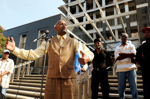 On the steps of City Hall July 25, King Salim Khalfani rails against the selection of Tompkins/Ballard to build a new city jail. While City Council ultimately backs Mayor Dwight Jones, Khalfani's pressure helped delay the vote — and forced the mayor to respond. - SCOTT ELMQUIST