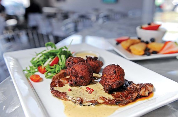One of the best dishes at Sample, a tech-focused small plates restaurant in the Fan, is the grilled rib-eye steak with French pepper sauce served with fried potatoes. - SCOTT ELMQUIST