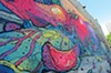 One of the murals in the G40 Art Summit featuring works by artists Roa, 2501 and Pixel Pancho located at 11 S. 18th St.