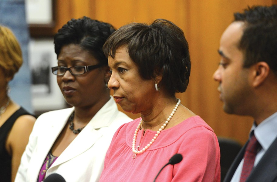 Outgoing Superintendent Yvonne Brandon, flanked by School Board Chairman Jeffrey Bourne and member Tichi Pinkney-Eppes, announces her resignation at City Hall. - SCOTT ELMQUIST
