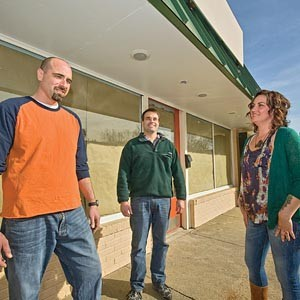 Over at The Mill on MacArthur, owners Josh Carlton, Chip Zimmerman and Amy Foxworthy mill around outside before checking out the interior improvements in progress at the new North Side cafe. It's expected to open in about a month. Photo by Ash Daniel