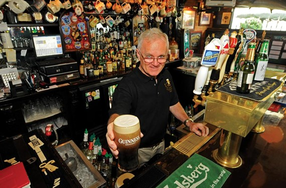 Owner Tommy Goulding pours a pint at Rosie Connolly's in Shockoe Bottom. - SCOTT ELMQUIST