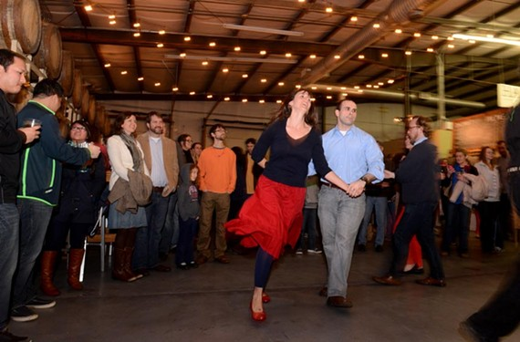 Participants swing their partners as part of this former River City Barn dance held at Hardywood Park Craft Brewery. Held at various locations, the event often features a bill of old-timey local bands.