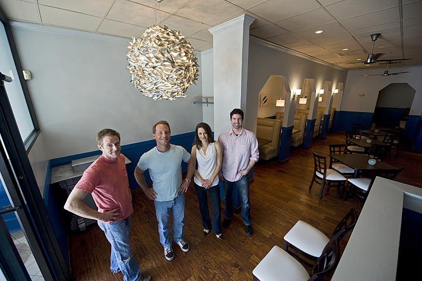 Partners Matthew Tlusty, Todd Manley, Tina Manley and Greg Smiley are giving the White Anchovy its final touches for an opening this month in west Henrico. - ASH DANIEL