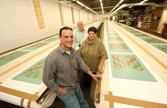 Paul Carter recently took over the company his parents, Robert and Argine Carter, have run since 1990. The Carters silk-screen historic wallpaper patterns on these 92-foot tables. - SCOTT ELMQUIST