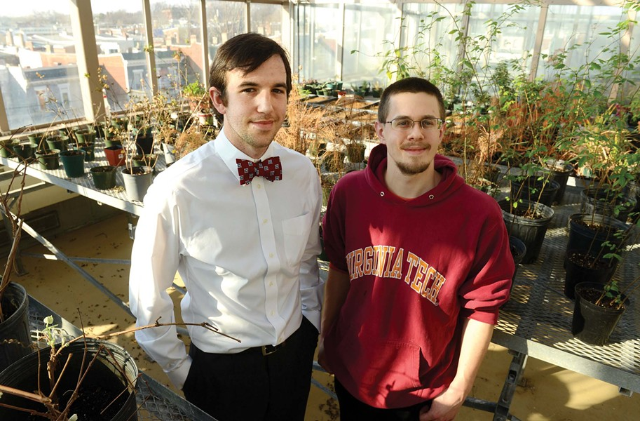Paul Manley and Stephen Via in their rooftop greenhouse on Cary Street. - SCOTT ELMQUIST
