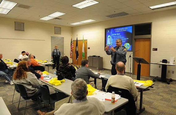 Police officer Larry Belviso covers safety and home security at the Henrico County session of Central Virginia Disaster Survivor Day. - SCOTT ELMQUIST