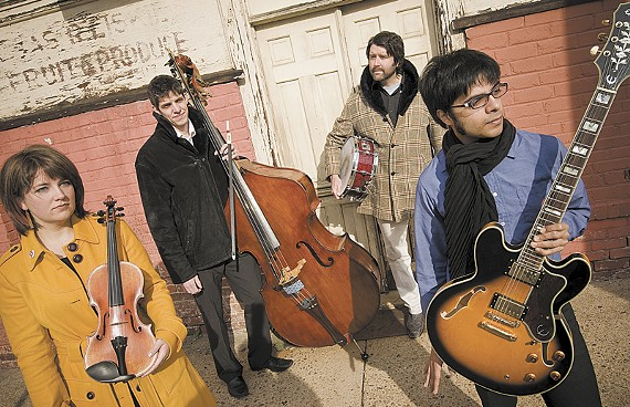 Prabir Mehta, at right, with his bandmates in Goldrush (Treesa Gold, Matt Gold and Gregg Brooks). In July, the Richmond-based band will participate in a rock-classical summit at the Omaha Music Conservatory. - ASH DANIEL/FILE