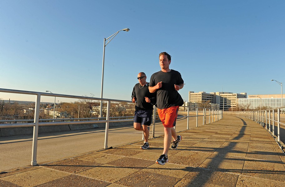 Preston Fox, a recovering addict living at the Healing Place, runs across the Ninth Street Bridge early Saturday morning as he trains for the Ukrop's Monument Avenue 10-K. - SCOTT ELMQUIST