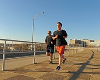 Preston Fox, a recovering addict living at the Healing Place, runs across the Ninth Street Bridge early Saturday morning as he trains for the Ukrop's Monument Avenue 10-K.