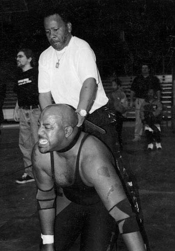 P.T. Brown chokes an opponent in October 2005. - P.T. BROWN