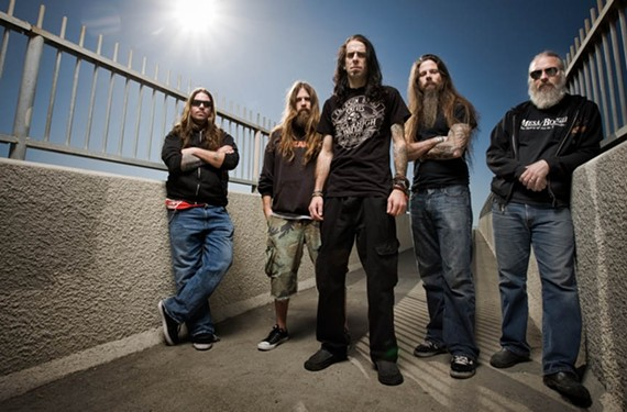 Randy Blythe, center, and Lamb of God.